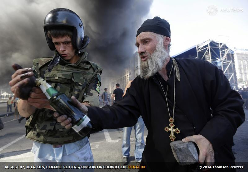 ukr_Reuters_priest_Kiev_war_mongers